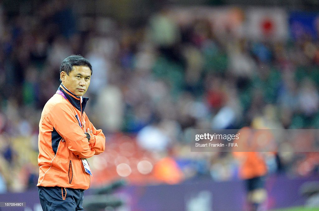 Norio Sasaki, head coach of Japan ponders during the Women's Football Quarter Final match between Brazil and Japan, on Day 7 of the London 2012 Olympic Games at Millennium Stadium on August 3, 2012 in Cardiff, Wales.