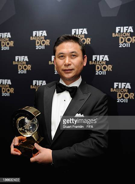 Norio Sasaki of Japan with his trophy after winning the FIFA World Coach of the Year for Women's Football award at the FIFA Ballon d'Or Gala 2011 at...