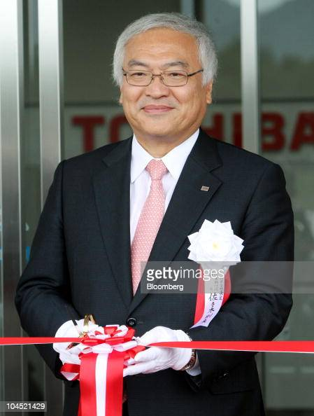 Norio Sasaki president and chief executive officer of Toshiba Corp cuts a ribbon during an opening ceremony of the company's Kashiwazaki operations...