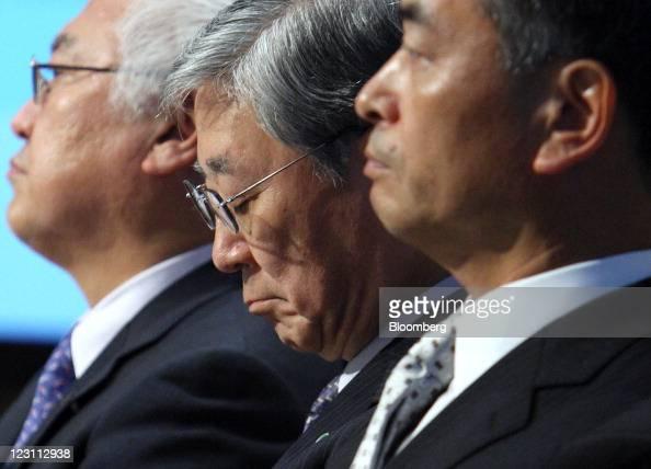 Norio Sasaki president and chief executive officer of Toshiba Corp left Hiroaki Nakanishi president of Hitachi Ltd center and Hiroshi Yoshioka...
