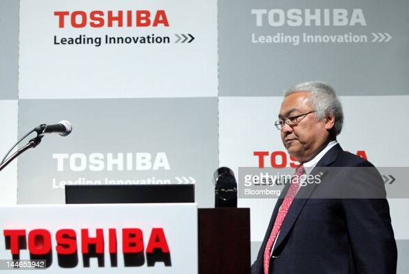 Norio Sasaki president and chief executive officer of Toshiba Corp walks to the podium during a news conference in Tokyo Japan on Thursday May 17...