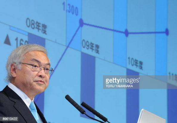 Norio Sasaki president of Japanese hightech giant Toshiba deliveres a speech during a press conference in Tokyo on August 5 2009 Toshiba was expected...