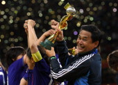 Norio Sasaki the coach of Japan lifts the Women's World Cup after victory over USA in the FIFA Women's World Cup Final match between Japan and USA at...