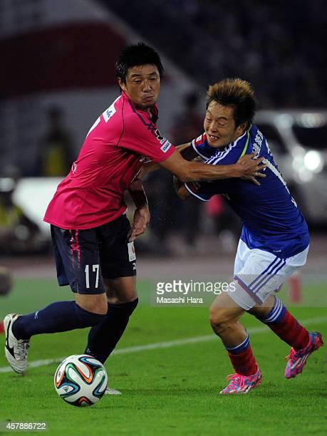 Noriyuki Sakemoto of Cerezo Osaka and Manabu Saito of Yokohama Fmarinos compete for the ball during the JLeague match between Yokohama FMarinos and...
