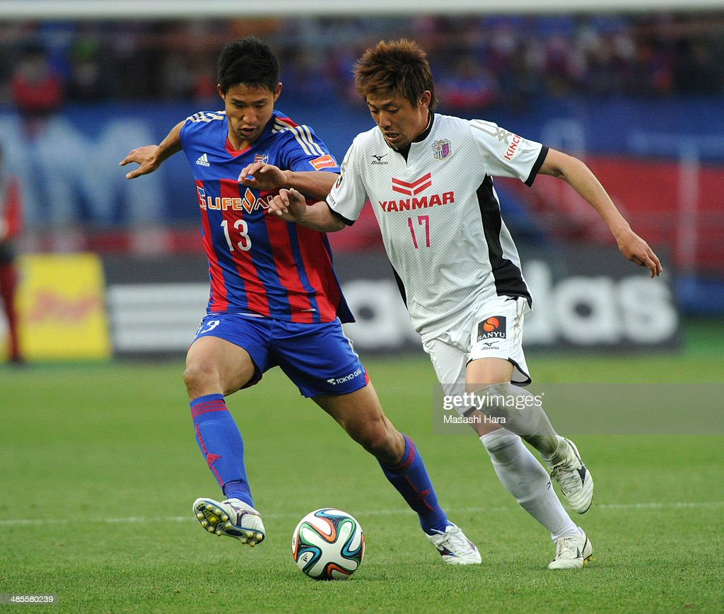 Noriyuki Sakemoto #17 of Cerezo Osaka (L) and <a gi-track='captionPersonalityLinkClicked' href=/galleries/search?phrase=Sota+Hirayama&family=editorial&specificpeople=2342529 ng-click='$event.stopPropagation()'>Sota Hirayama</a> #13 of FC Tokyo compete for the ball during the J.League match between F.C. Tokyo and Cerezo Osaka at Ajinomoto Stadium on April 19, 2014 in Tokyo, Japan.