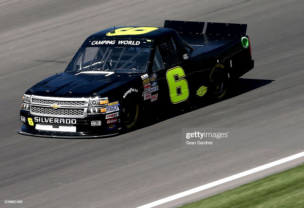 Norm Benning, driver of the #6 Chevrolet, drives during qualifying for the NASCAR Camping World Truck Series Toyota Tundra 250 at Kansas Speedway on May 6, 2016 in Kansas City, Kansas.