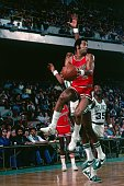 Norm Van Lier of the Chicago Bulls looks to pass against the Boston Celtics during a game played in 1976 at the Boston Garden in Boston Massachusetts...