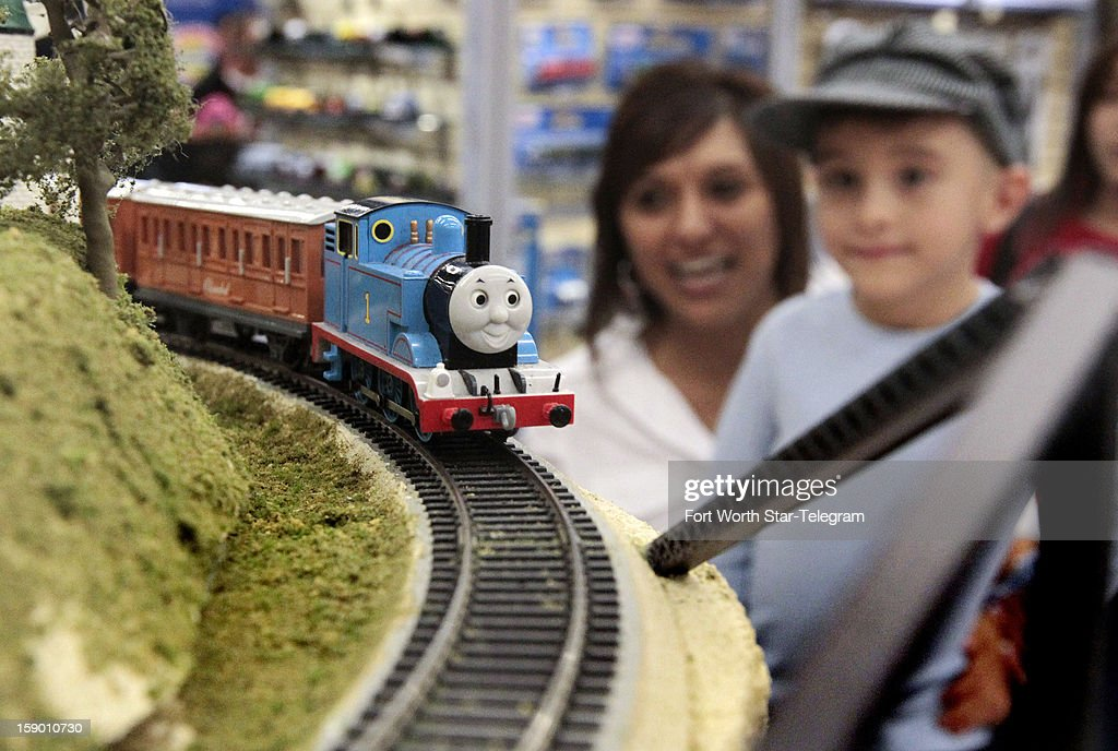 Norma Alonso of Fort Worth, Texas, holds up her son, Gabriel Alonso, 5, as Thomas the Tank Engine passes by at the World's Greatest Hobby on Tour train show at Will Rogers Memorial Center in Fort Worth, Saturday, January 5, 2013.