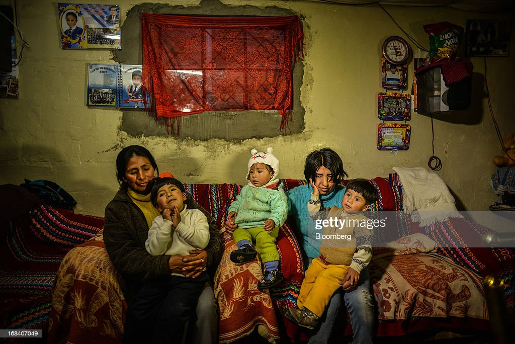 Norma Figueroa, left, sits with her children and Oshin Onofre, right, in the town of La Oroya, Peru, on Tuesday, March 19, 2013. Most of La Oroyaís children suffer elevated lead levels, according to the Peruvian government. The question of responsibility for lead pollution in La Oroya is at the center of high-stakes clash between Peru and U.S. billionaire Ira Rennert, who owned Doe Run Peru for more than a decade through Renco Group Inc., a metals, mining and industrial conglomerate based in New York that has said it is not responsible for the childrenís ills. Photographer: Meridith Kohut/Bloomberg via Getty Images