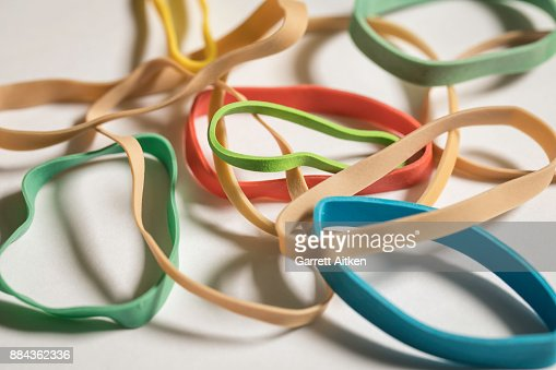 Normal And Colored Rubber Bands : Stock Photo
