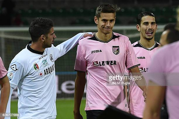 Norman Balogh of Palermo is conforted by Pietro Ceccaroni of Spezia after losing the TIM Cup match between US Citta di Palermo and AC Spezia at...