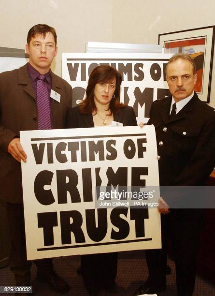 PC Norman Brennan the Director of the Victims of crime Trust with Paul and Jayne Walmsley the parents of 14 year old Luke who was stabbed to death at...