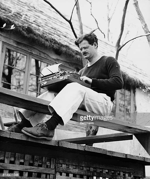 Norman Corwin writer director producer and lecturer typing manuscript astride bench on sundeck of Piermont NY home
