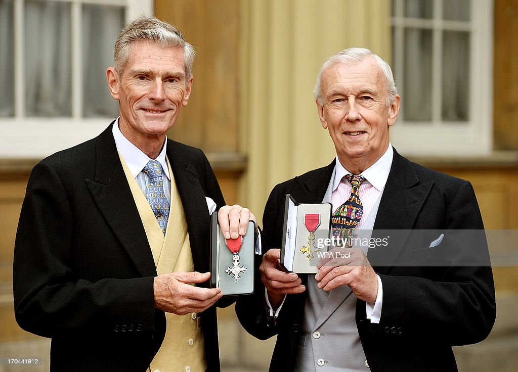 Norman Gundill (L) proudly holds his MBE (Member of the British Empire) Medal, with John Sanderson holding his OBE (Order of the British Empire) Medal after it was presented to them by Queen Elizabeth II, at the Investiture ceremony at Buckingham Palace on June 13, 2013 in London, England.