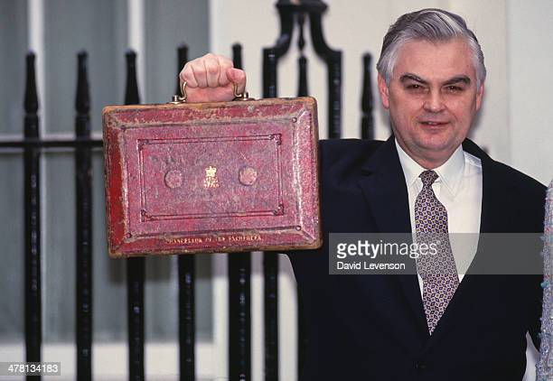 Norman Lamont Chancellor of the Exchequer poses with his budget case on the steps of 11 Downing Street before presenting his Budget to Parliament on...