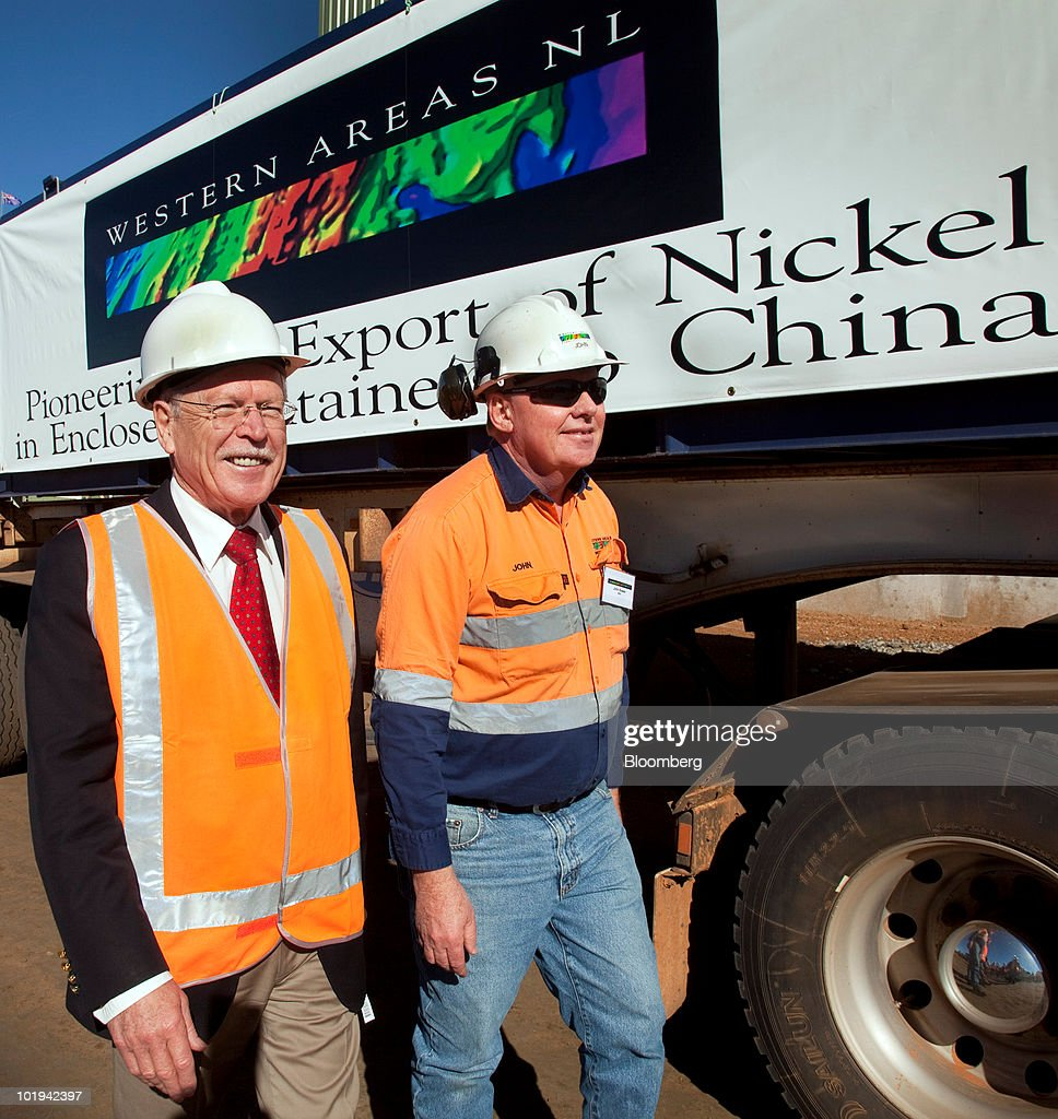 Norman Moore, Western Australia's mines and petroleum minister, left, and John Bower, Cosmic Boy nickel concentrate plant manager, walk past enclosed containers for the shipping of nickel ore at Western Areas NL's Tim King Pit open-cut nickel mine at Spotted Quoll, in Forrestania, Western Australia, on Thursday, June 10, 2010. Western Areas NL is an exploration company that is involved in the development of the Fox Nickel mine and the exploration of nickel sulfides, platinum group metals and gold. Photographer: Ron D'Raine/Bloomberg via Getty Images