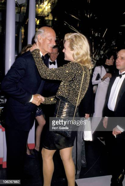 Norman Parkinson and Patti Hansen during 'Hooray For Hollywood' AIDS Benefit April 5 1988 at Bloomingdale's in New York City New York United States