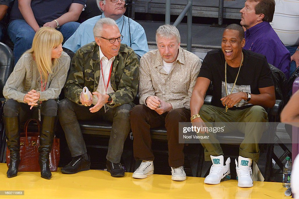 Norman Pattiz (2L) and Jay Z (R) attend a basketball game between the Oklahoma City Thunder and the Los Angeles Lakers at Staples Center on January 27, 2013 in Los Angeles, California.
