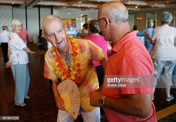 Norman Pelletir of Lawrence Mass leans past Harry Fullerton of Wakefield Mass to say hello to a friend during an LGBT senior luncheon in Boston on...