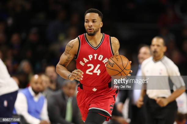 Norman Powell of the Toronto Raptors brings the ball up court during the game against the Detroit Pistons at the Palace of Auburn Hills on March 17...
