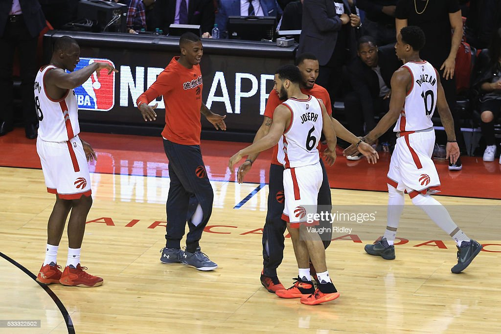 Norman Powell #24 of the Toronto Raptors congratulates Cory Joseph #6 after a made three-point basket during the second half against the Cleveland Cavaliers in game three of the Eastern Conference Finals during the 2016 NBA Playoffs at Air Canada Centre on May 21, 2016 in Toronto, Canada.