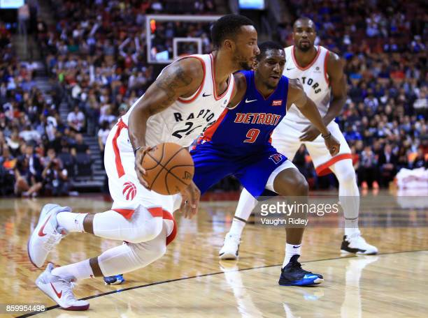 Norman Powell of the Toronto Raptors dribbles the ball as Langston Galloway of the Detroit Pistons defends during the second half of an NBA preseason...