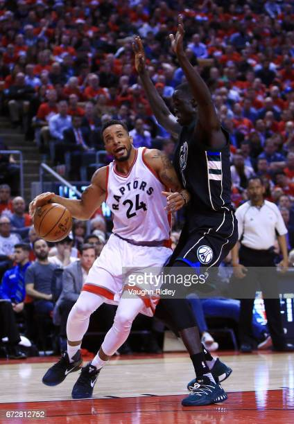 Norman Powell of the Toronto Raptors dribbles the ball as Thon Maker of the Milwaukee Bucks defends in the first half of Game Five of the Eastern...
