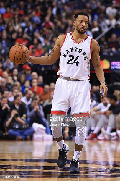 Norman Powell of the Toronto Raptors dribbles the ball during the second half of an NBA game against the Milwaukee Bucks at Air Canada Centre on...