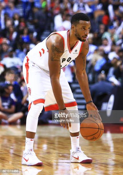 Norman Powell of the Toronto Raptors dribbles the ball during the second half of an NBA preseason game against the Detroit Pistons at Air Canada...