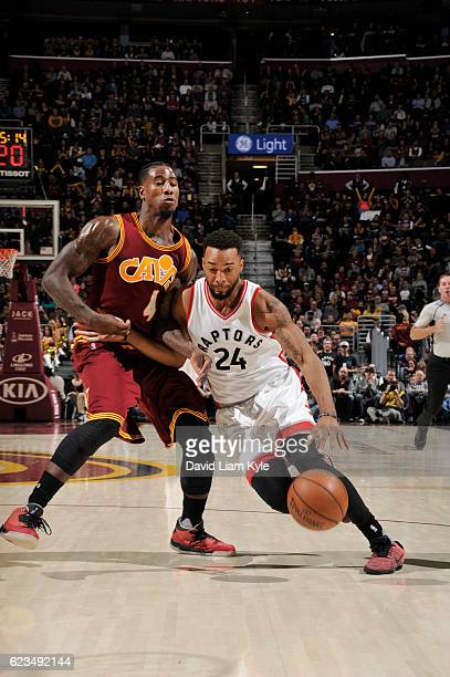 Norman Powell of the Toronto Raptors drives to the basket against Iman Shumpert of the Cleveland Cavaliers during a game on November 15 2016 at...