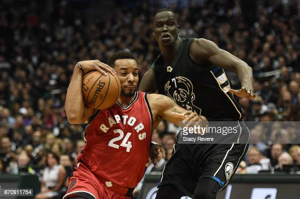 Norman Powell of the Toronto Raptors drives to the basket against Thon Maker of the Milwaukee Bucks during the second half of Game Three of the...