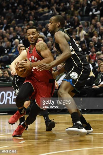 Norman Powell of the Toronto Raptors drives to the basket against Khris Middleton of the Milwaukee Bucks during the second half of Game Three of the...