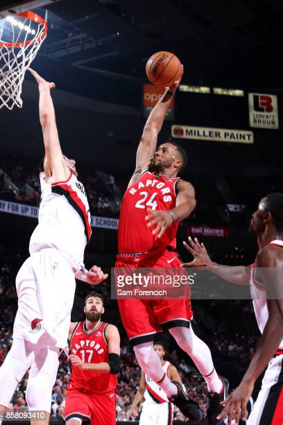 Norman Powell of the Toronto Raptors dunks the ball during the game against the Portland Trail Blazers during a preseason game on October 5 2017 at...