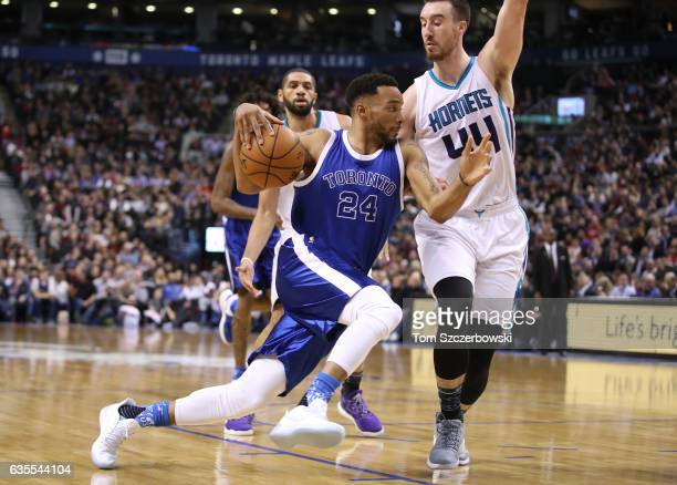 Norman Powell of the Toronto Raptors goes to the basket against Frank Kaminsky of the Charlotte Hornets during NBA game action at Air Canada Centre...