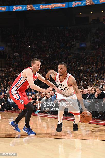 Norman Powell of the Toronto Raptors handles the ball against the Philadelphia 76ers on April 12 2016 at the Air Canada Centre in Toronto Ontario...