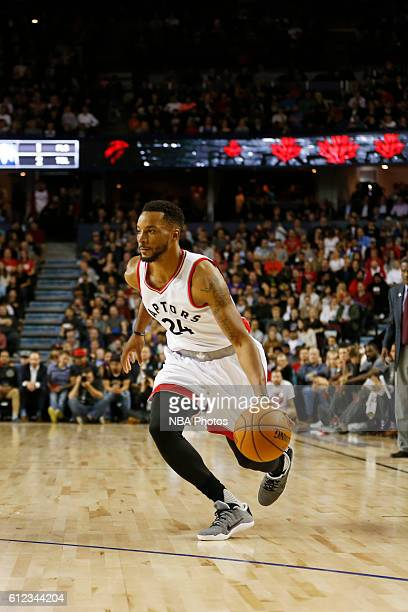 Norman Powell of the Toronto Raptors handles the ball against the Denver Nuggets on October 3 2016 at the Scotiabank Saddledome in Calagary Alberta...