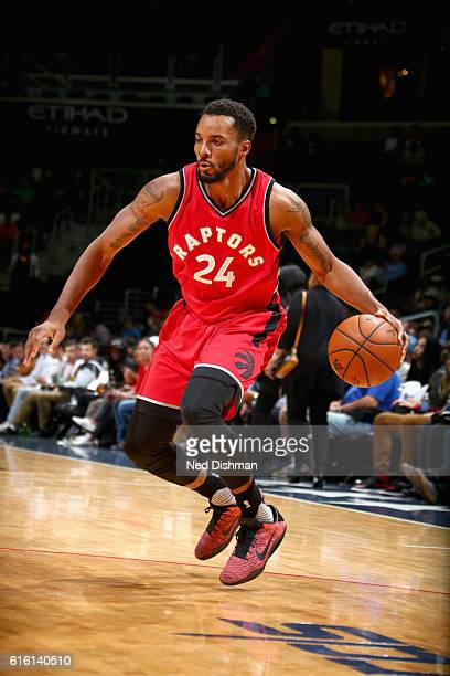 Norman Powell of the Toronto Raptors handles the ball against the Washington Wizards during a preseason game on October 21 2016 at Verizon Center in...