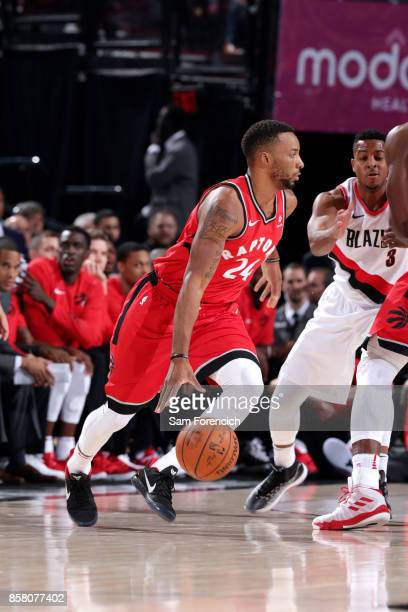 Norman Powell of the Toronto Raptors handles the ball during the game against the Portland Trail Blazers during a preseason game on October 5 2017 at...