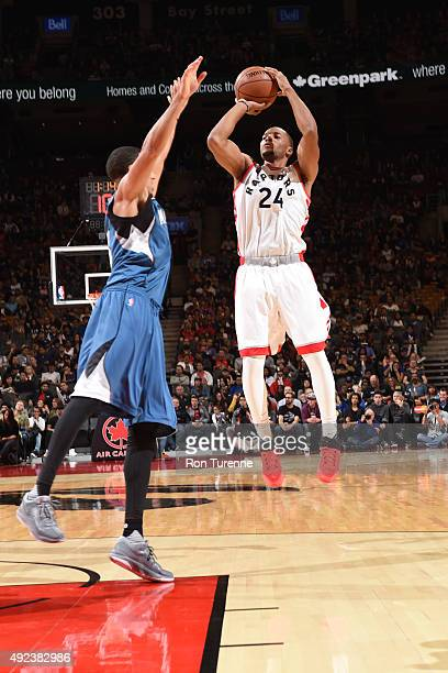 Norman Powell of the Toronto Raptors shoots against the Minnesota Timberwolves on October 12 2015 at the Air Canada Centre in Toronto Ontario Canada...