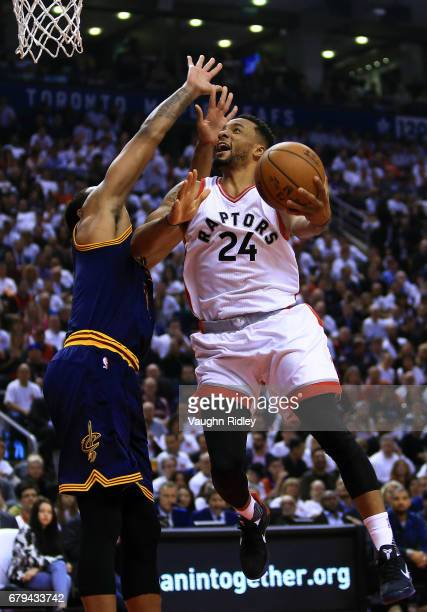 Norman Powell of the Toronto Raptors shoots the ball as Kyrie Irving of the Cleveland Cavaliers guards in the first half of Game Three of the Eastern...