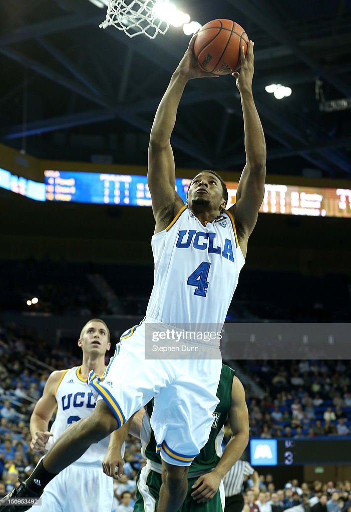 Norman Powell #4 of the UCLA Bruins shoots against the Cal Poly Mustangs at Pauley Pavilion on November 25, 2012 in Los Angeles, California. Cal Poly won 70-68.