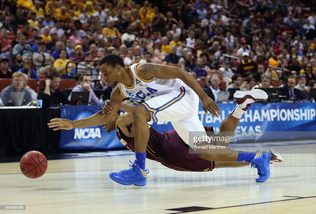 Norman Powell #4 of the UCLA Bruins steals the ball from Andre Hollins #1 of the Minnesota Golden Gophers during the second round of the 2013 NCAA Men's Basketball Tournament at The Frank Erwin Center on March 22, 2013 in Austin, Texas.