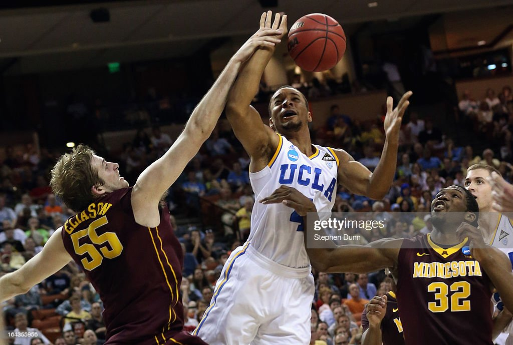 Norman Powell #4 of the UCLA Bruins takes a shot over Elliott Eliason #55 and <a gi-track='captionPersonalityLinkClicked' href=/galleries/search?phrase=Trevor+Mbakwe&family=editorial&specificpeople=4898343 ng-click='$event.stopPropagation()'>Trevor Mbakwe</a> #32 of the Minnesota Golden Gophers during the second round of the 2013 NCAA Men's Basketball Tournament at The Frank Erwin Center on March 22, 2013 in Austin, Texas.