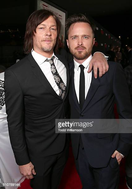 Norman Reedus and Aaron Paul attend the premiere Of Open Road's 'Triple 9' at Regal Cinemas LA Live on February 16 2016 in Los Angeles California