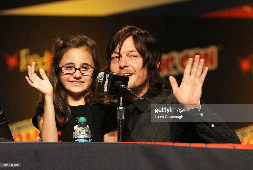 <a gi-track='captionPersonalityLinkClicked' href=/galleries/search?phrase=Norman+Reedus&family=editorial&specificpeople=747258 ng-click='$event.stopPropagation()'>Norman Reedus</a> and fan attend 'The Walking Dead' Panel at New York Comic Con at Jacob Javits Center on October 12, 2013 in New York City.