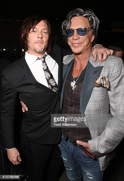 Norman Reedus and Mickey Rourke attend the premiere Of Open Road's 'Triple 9' at Regal Cinemas LA Live on February 16 2016 in Los Angeles California