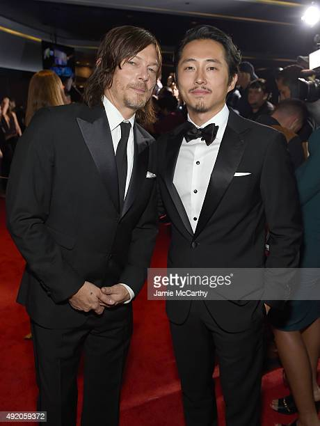 Norman Reedus and Steven Yeun attend AMC's 'The Walking Dead' Season 6 Fan Premiere Event 2015 at Madison Square Garden on October 9 2015 in New York...