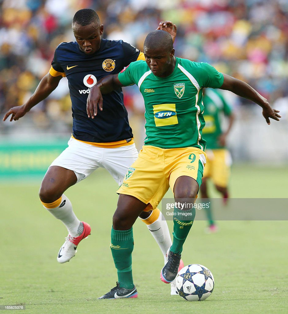 Norman Smith battles with simonise Gaxa during the Absa Premiership match between Golden Arrows and Kaizer Chiefs at Moses Mabhida Stadium on April 06, 2013 in Durban, South Africa.