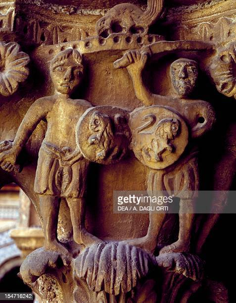 Norman soldiers detail of a cloister capital relief Cathedral dedicated to Santa Maria Nuova Monreale Sicily Italy 12th century