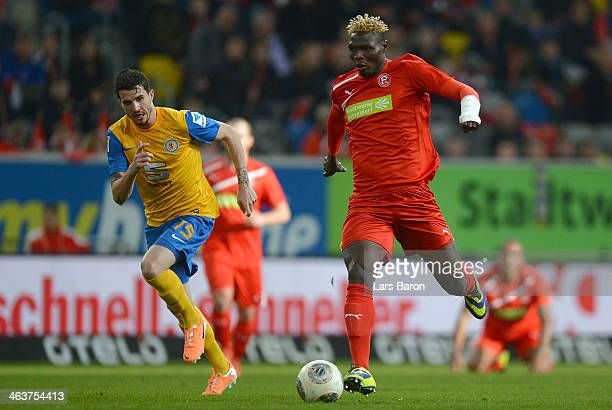 Norman Theuerkauf of Braunschweig challenges Aristide Bance of Duesseldorf during the Stadtwerke Duesseldorf Wintercup 2014 semifinal match between...